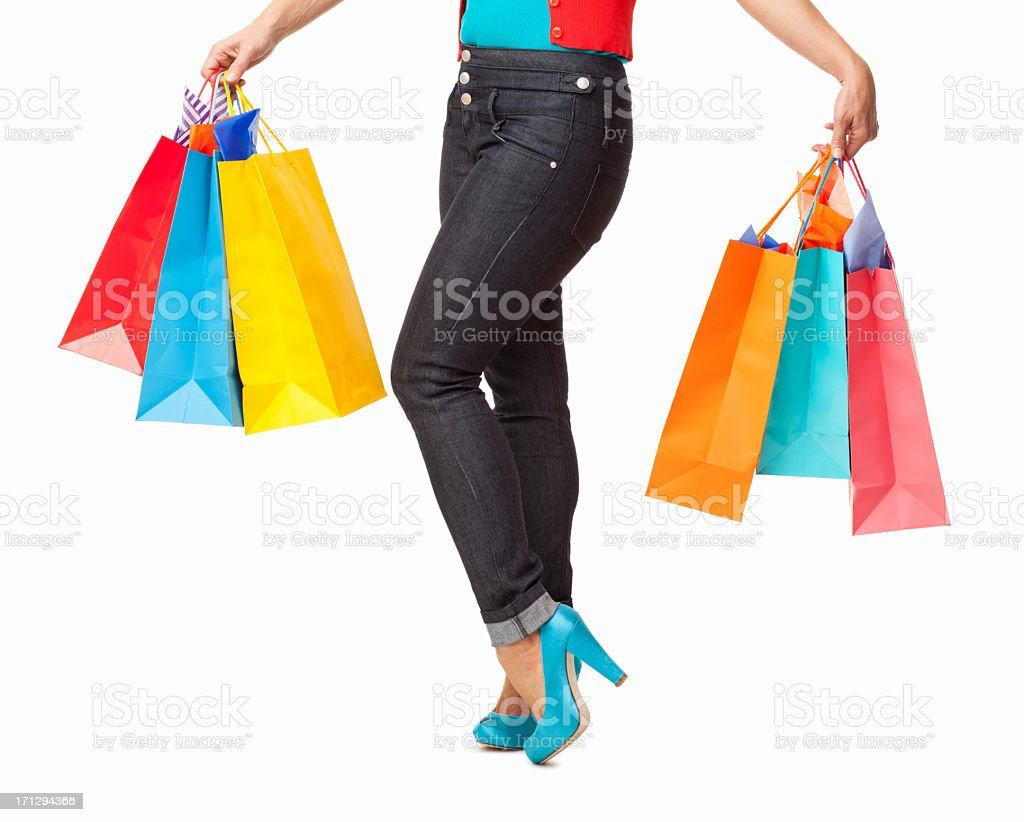 Female Holding Colorful Shopping Bags - Isolated royalty-free stock photo