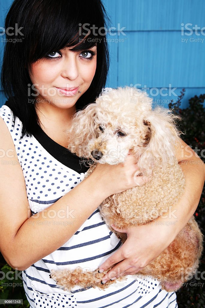 Female Holding Dog in Arms Portrait royalty-free stock photo