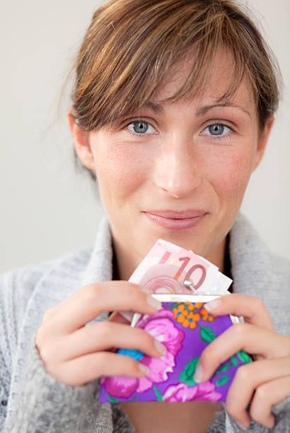 female holding money pocket stock photo