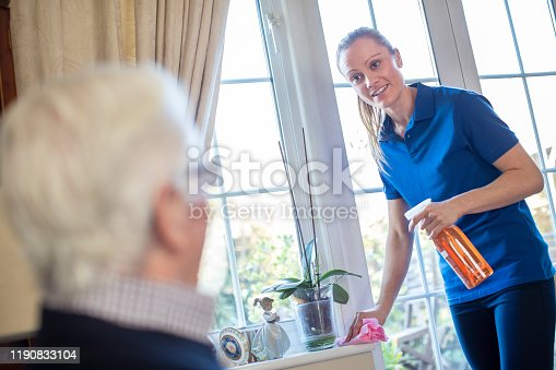 istock Female Home Help Cleaning House For Senior Man 1190833104