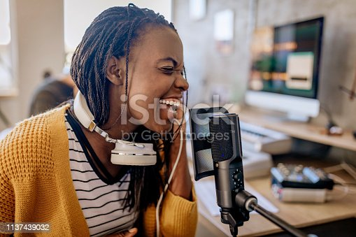 istock Female host on radio station 1137439032