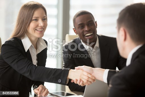 istock Female HR manager handshaking with job applicant 843533986