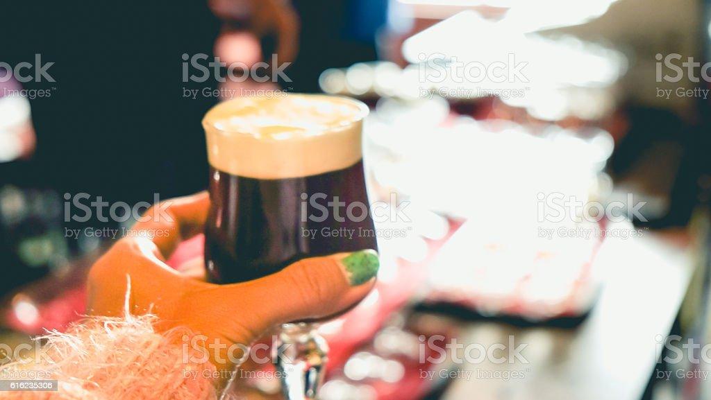 Female human hands holding Irish coffee stock photo