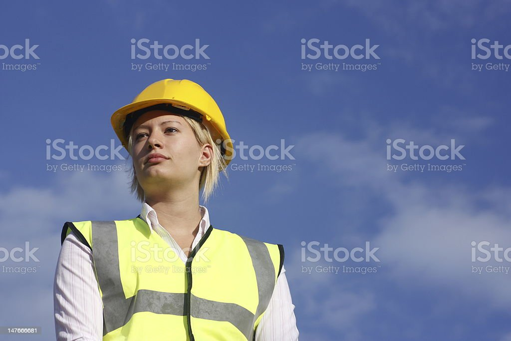 Female in a hard hat and safety vest. royalty-free stock photo
