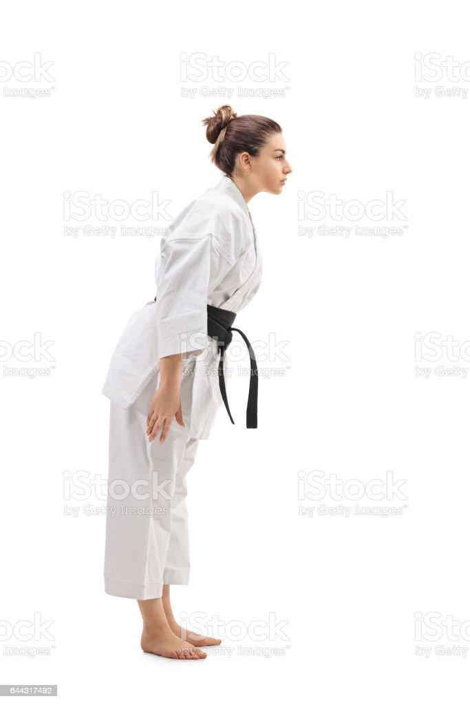 Female in a kimono bowing down stock photo