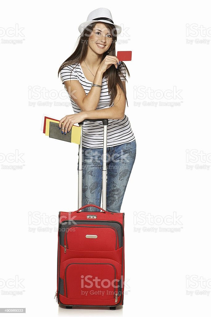 Female in casual standing with travel suitcase stock photo