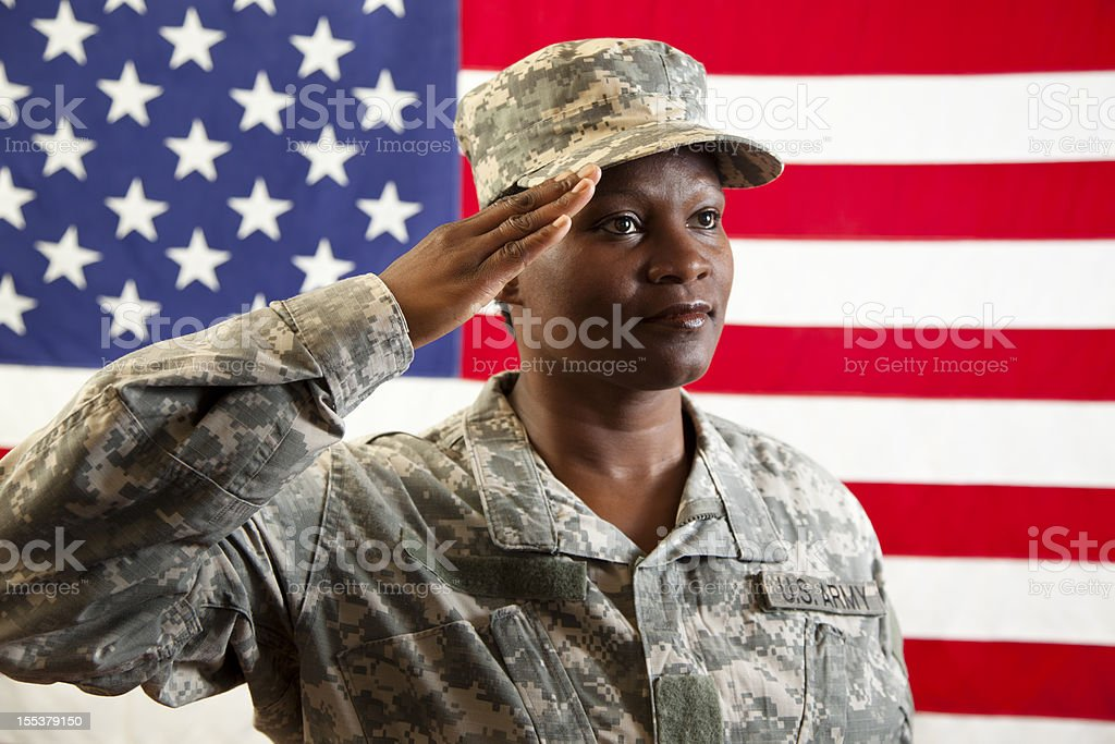 Female in military army uniform saluting American flag. Soldier. - Stock  image . 7b33c38acaf7