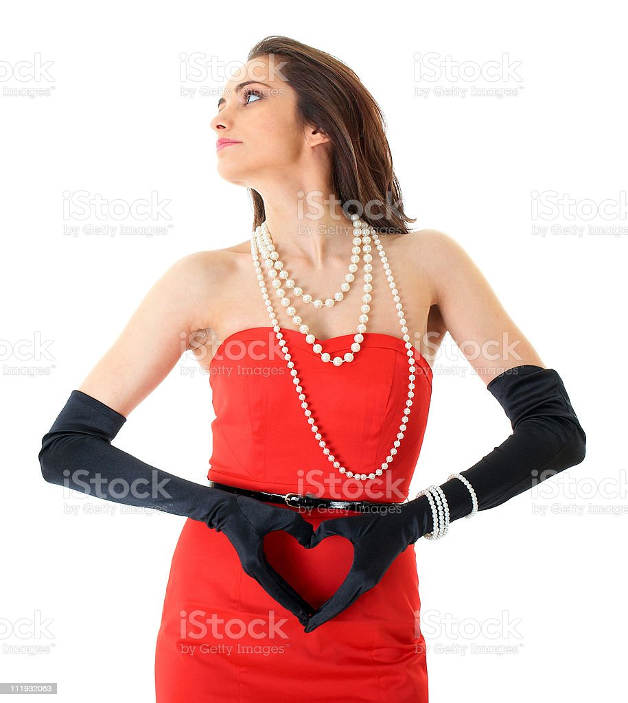 female in red dress with heart shaped hands, isolated stock photo