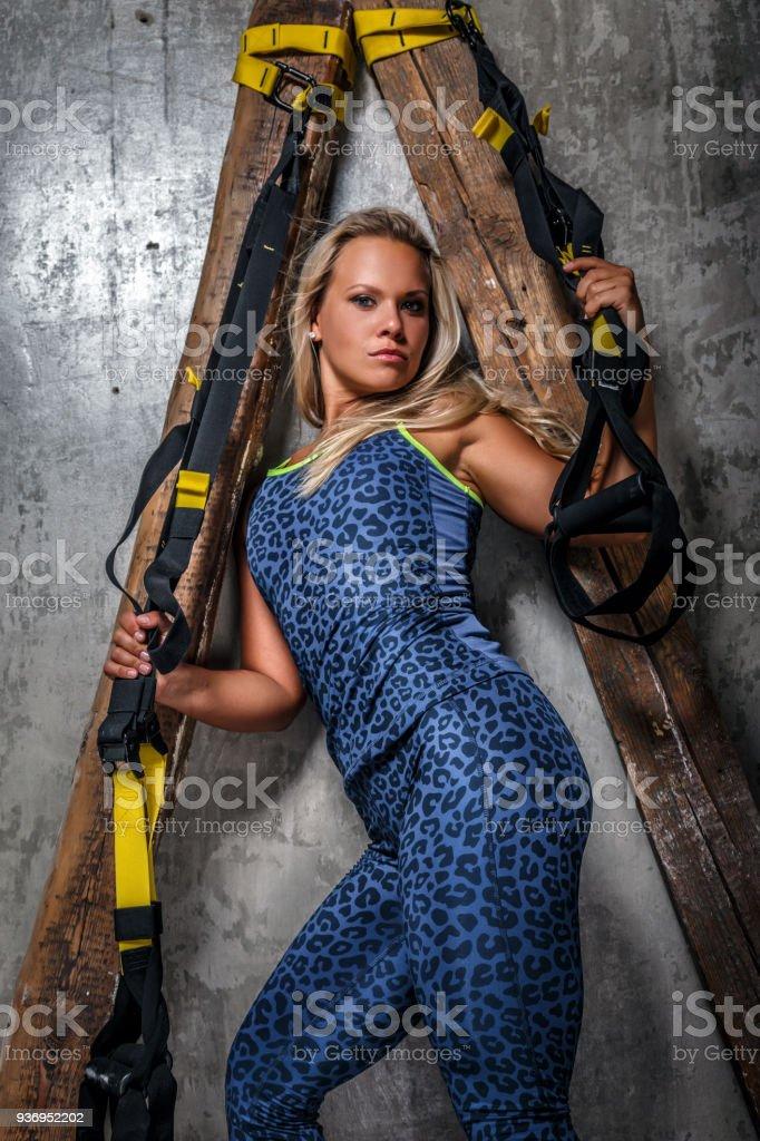 Female in sportswear doing fitness. stock photo