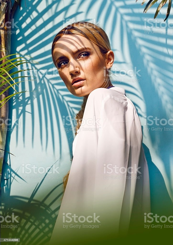 Female in the jungle, under palm trees stock photo