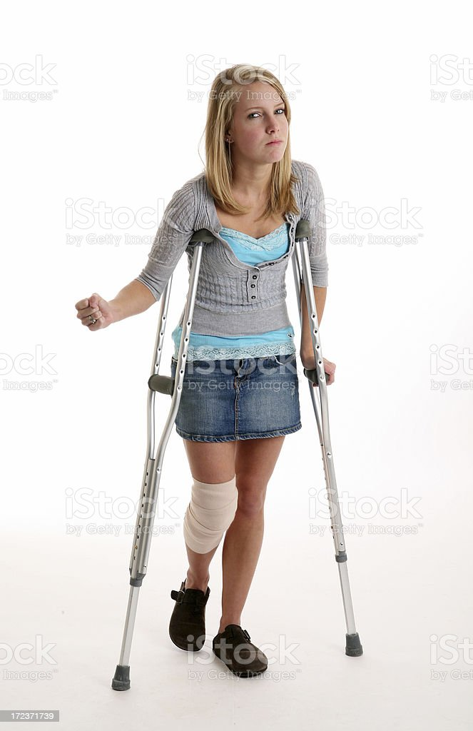 female injured on crutches royalty-free stock photo