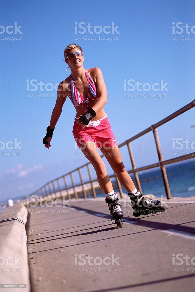 Female in-line skating royalty-free stock photo