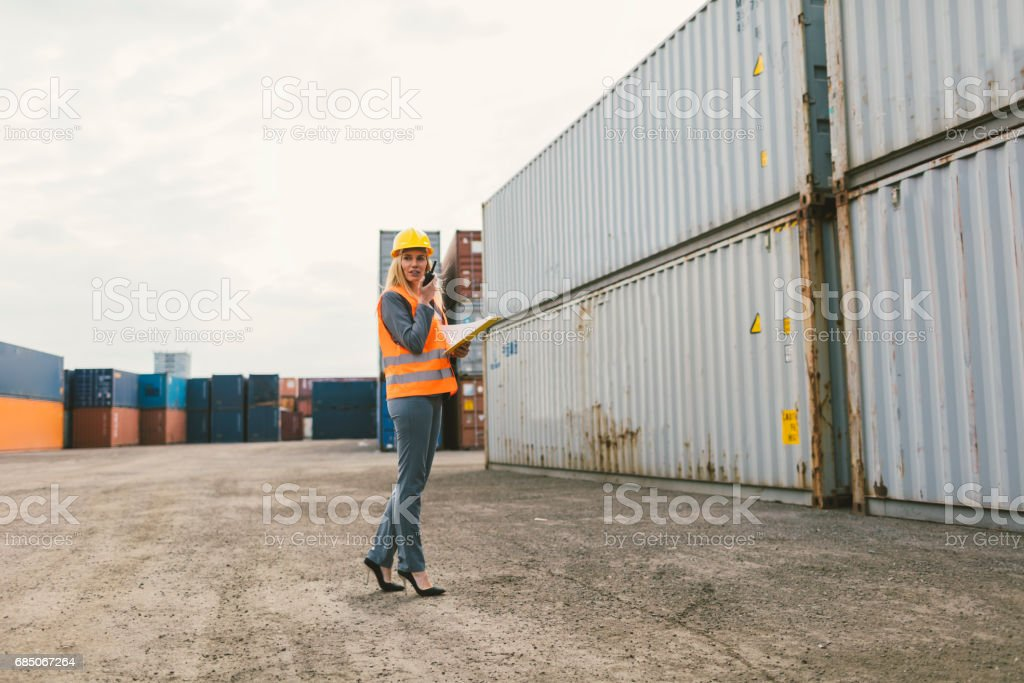 Female inspectors checking cargo containers royalty-free stock photo