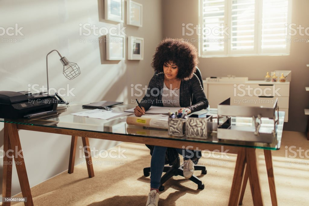 Female interior designer working at home office stock photo