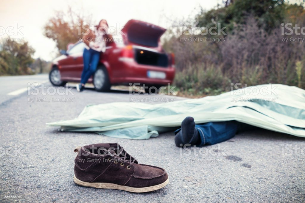 Female involved in fatal automobile accident feeling depressed stock photo