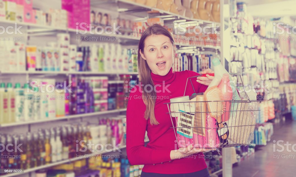 female is holding modern hair care goods royalty-free stock photo
