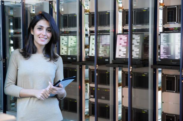 Female IT engineer in data center stock photo
