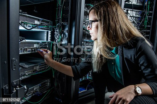 Female IT Engineer Working in Server Room.