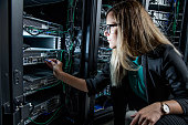Female IT Engineer Working in Server Room