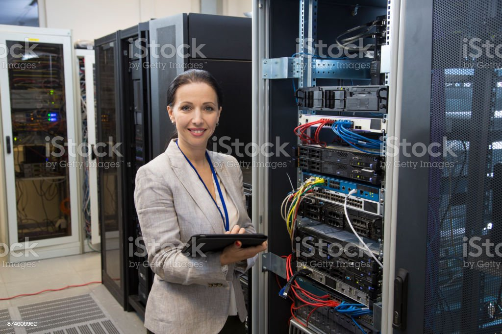 Female IT professional portrait in server room stock photo