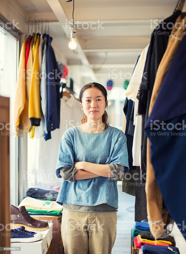 Female Japanese Resale Shop Owner in her Store ストックフォト