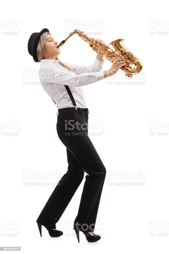 Female jazz musician playing a saxophone stock photo
