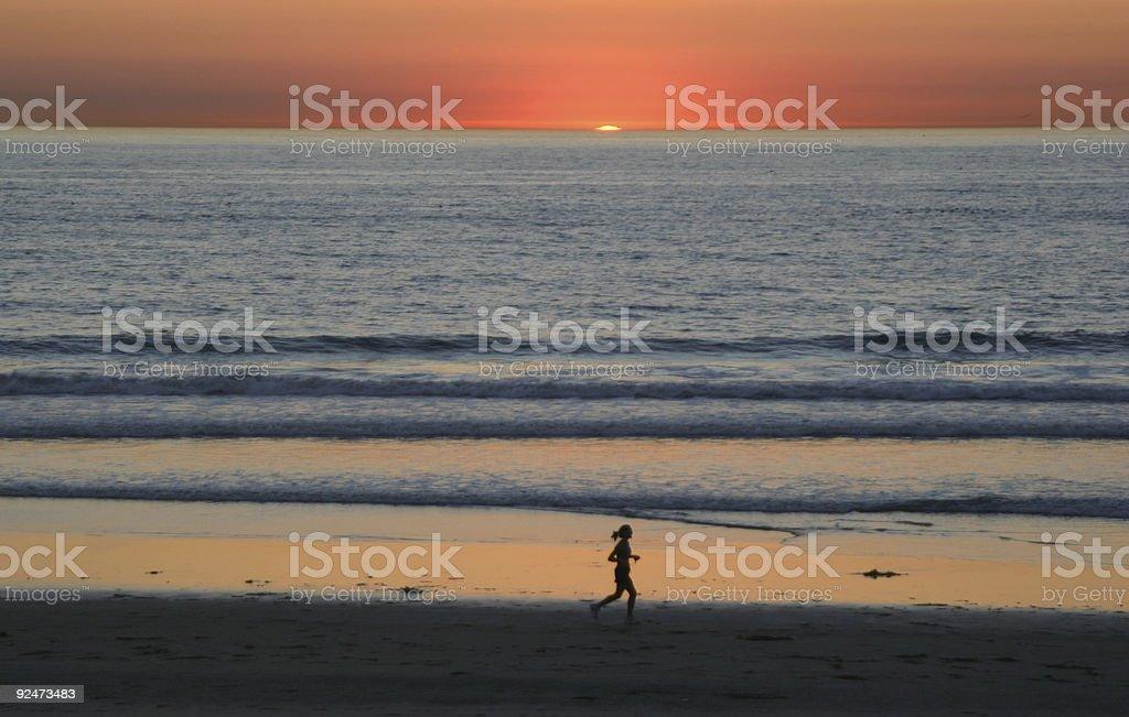 female jogger at sundown royalty-free stock photo