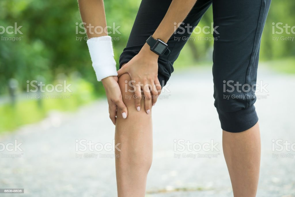 Female Jogger Having Pain In Her Knee stock photo