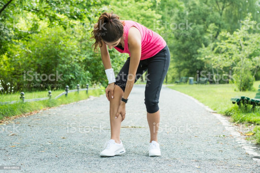 Female Jogger Having Pain In Her Leg stock photo