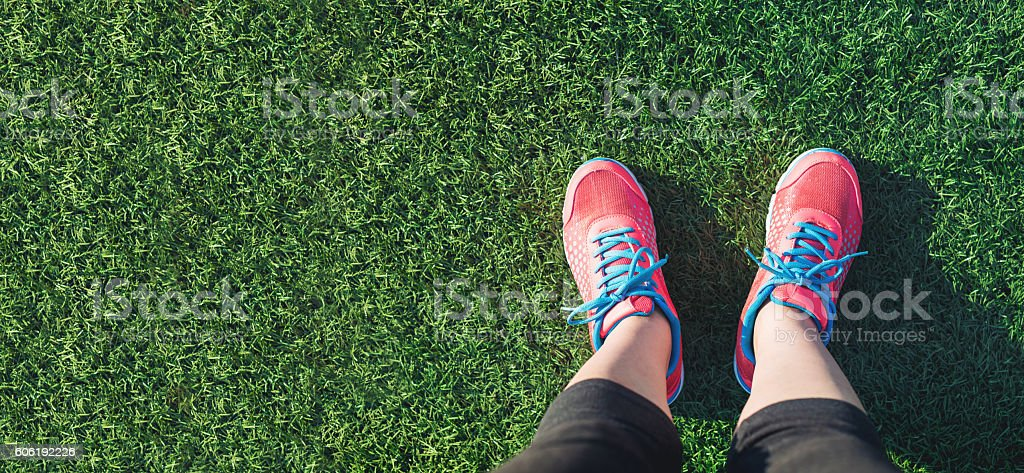 Female jogger looking down at her feet stock photo