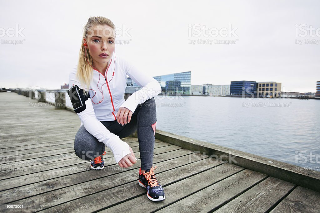 Female jogger outdoors looking confident royalty-free stock photo