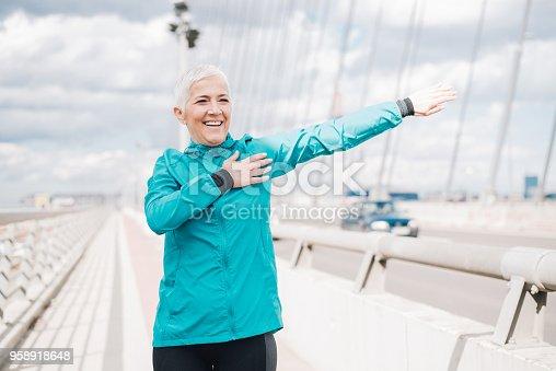 1057638814 istock photo Female jogger stretching 958918648