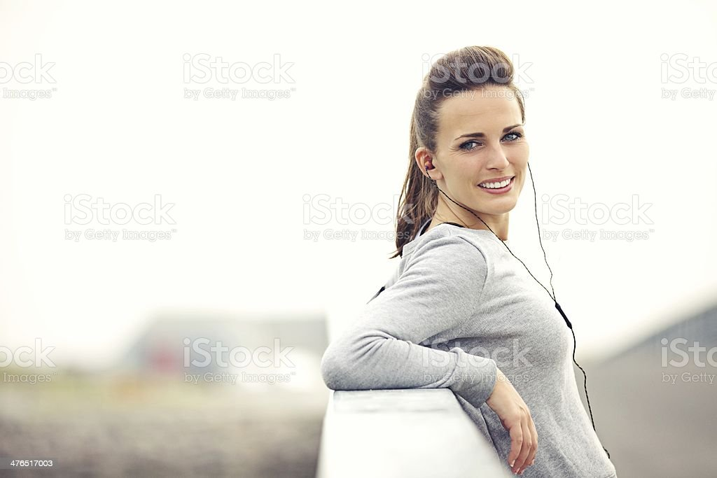 Female Jogger with MP3 Player Resting royalty-free stock photo