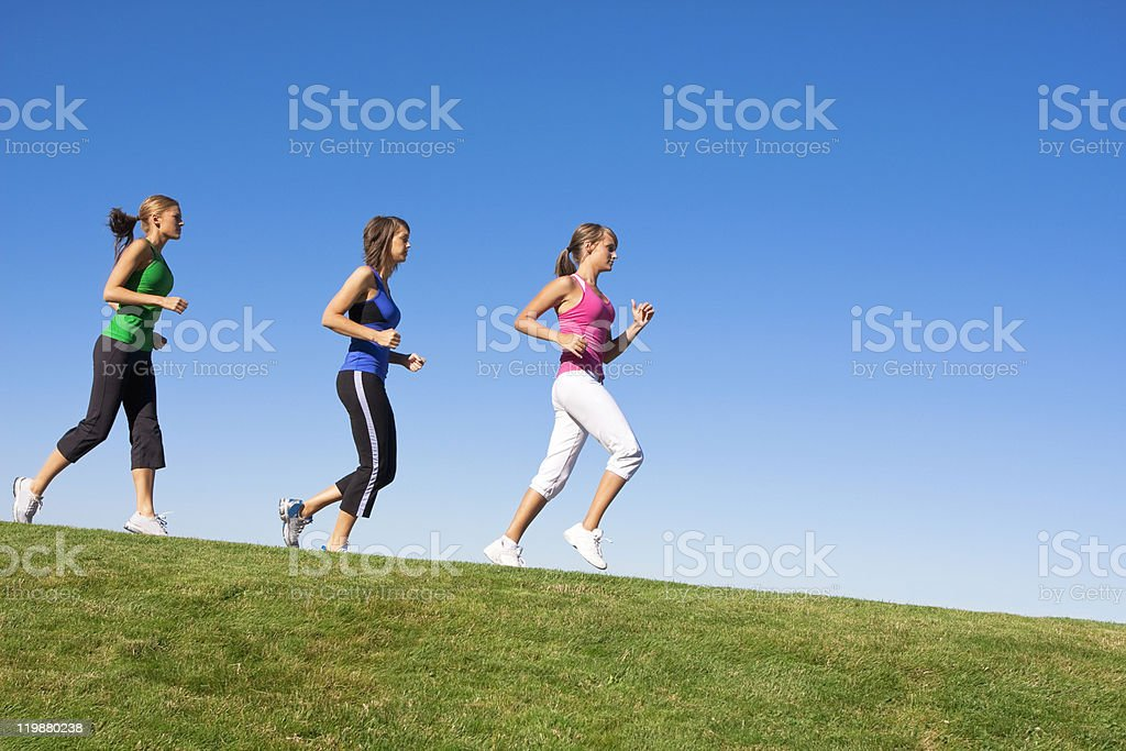Female Joggers on the horizon stock photo