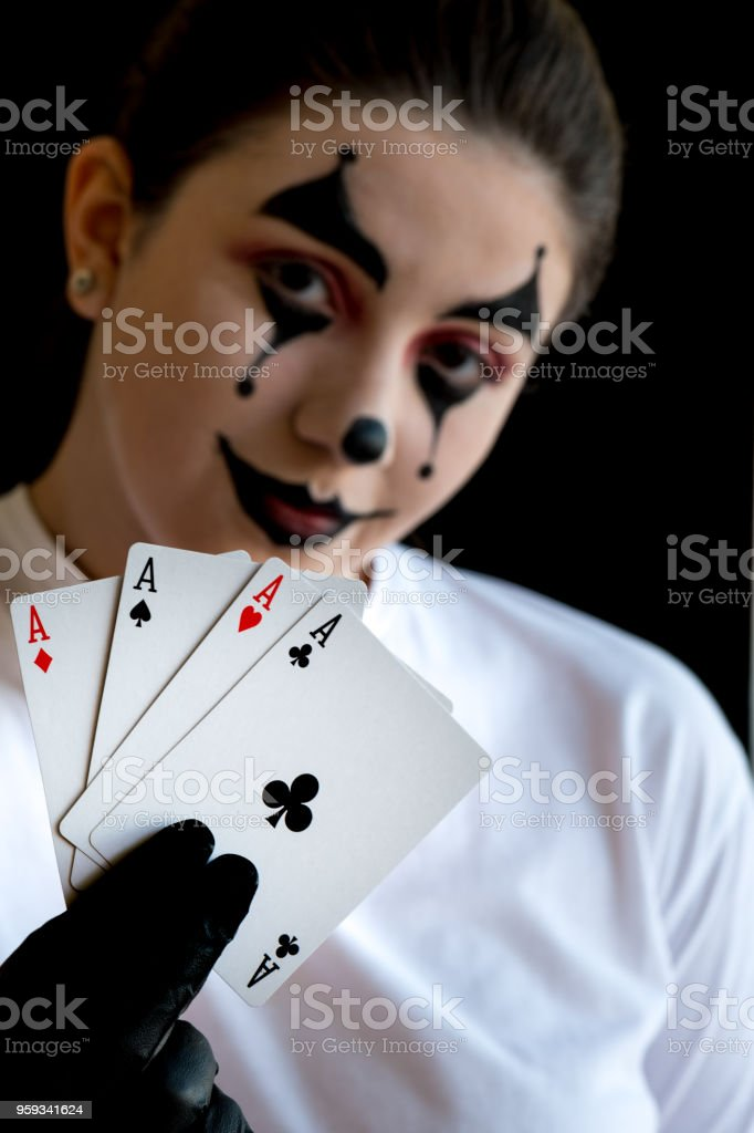 female joker showing a poker of ACEs stock photo