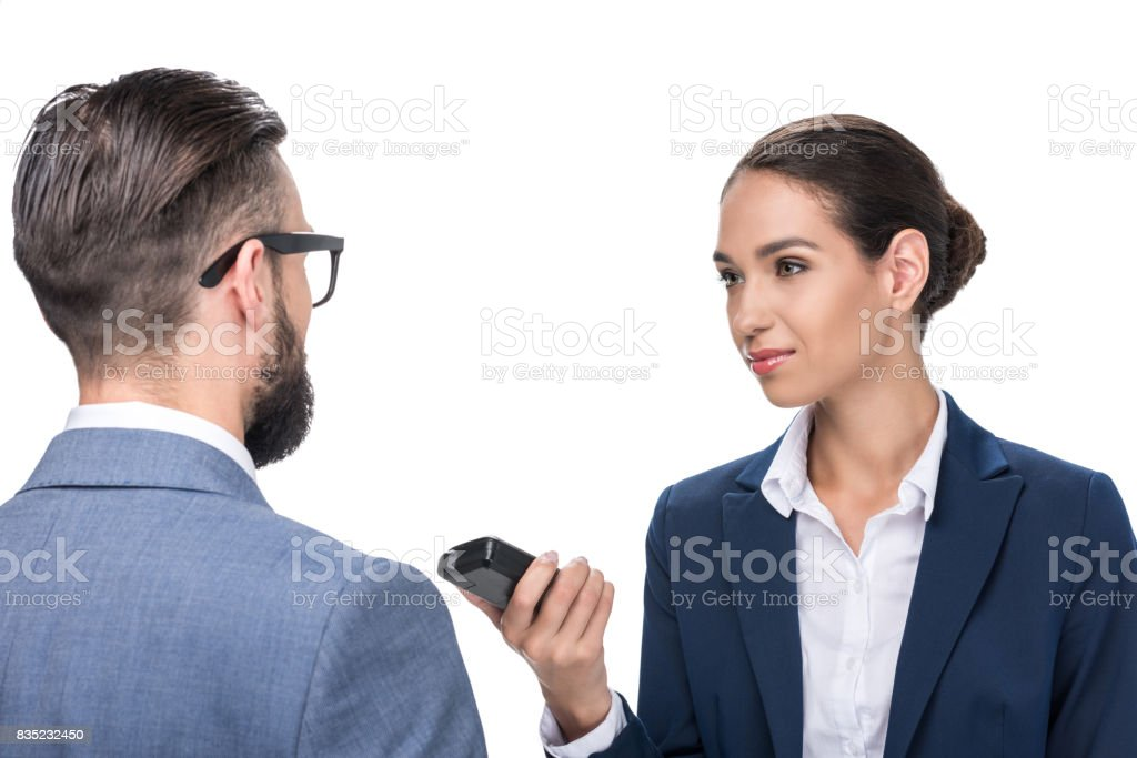 female journalist taking interview with businessman, isolated on white stock photo