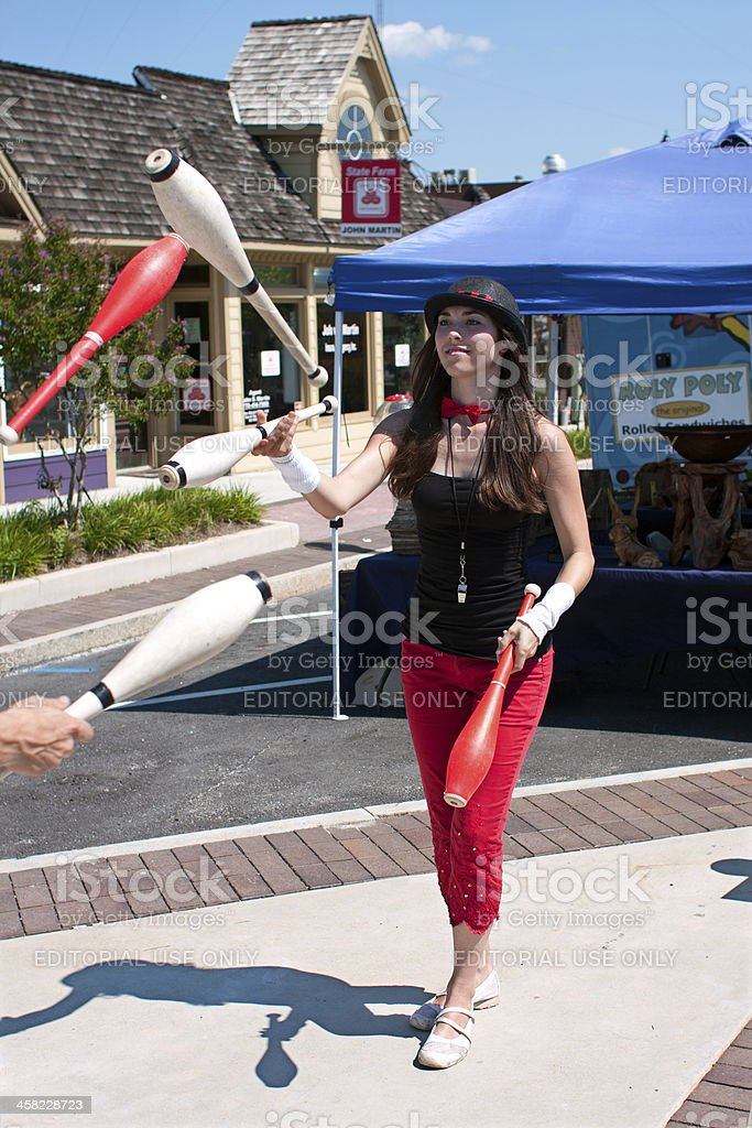 Female Juggler Performs At Summer Festival royalty-free stock photo