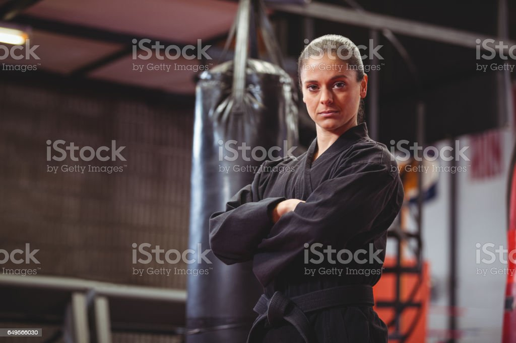 Female karate player performing karate stance stock photo