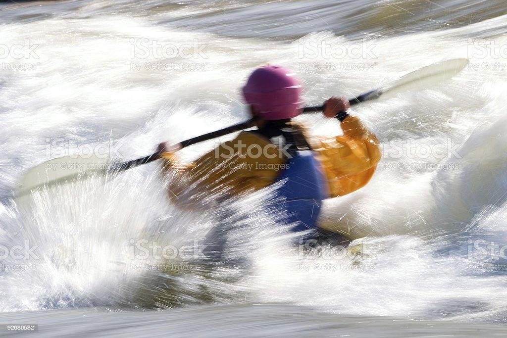 Female kayaker on whitewater rapid royalty-free stock photo