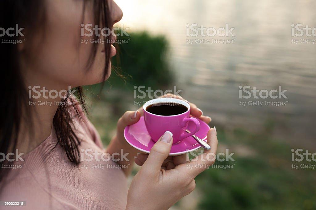 female keep cup of coffee near lake or river; royaltyfri bildbanksbilder