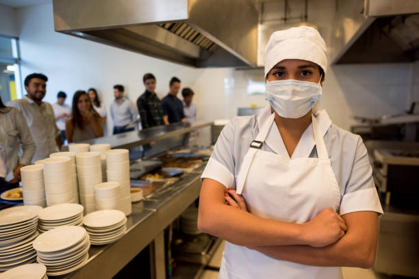 Female kitchen assistant working at a buffet restaurant wearing a picture id954735608?b=1&k=6&m=954735608&s=612x612&w=0&h=dw6dcl3rdyjapoklfejizefdrkkvr s7jt9ctgparyg=