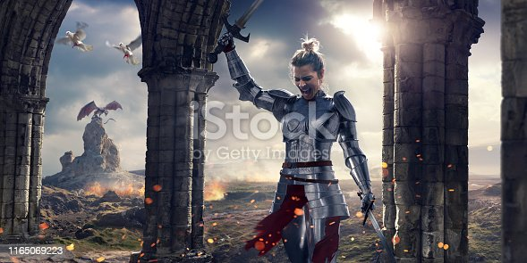 Fantasy image of a female medieval knight, wearing suit of armour with helmet removed, holding two swords, one held above head. The knight is walking past some stone pillars and arches as two doves fly past. Behind her is a fire scorched terrain with a dragon resting on a rock.