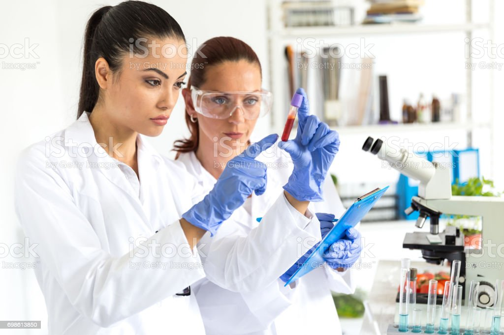Female laboratory technicians making tests stock photo