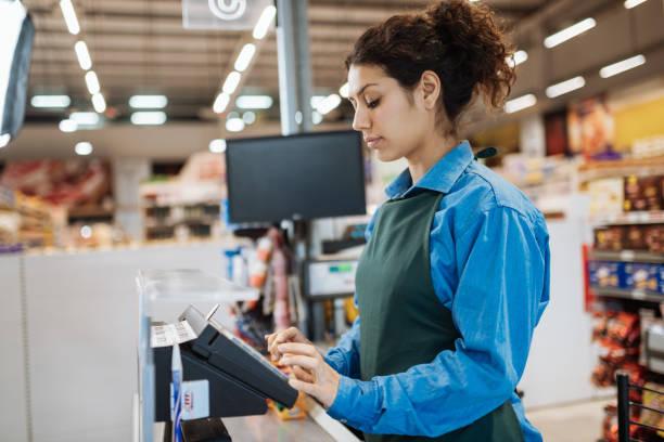 Female Latina employee in supermarket stock photo
