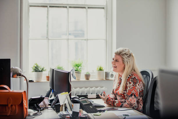 Female Laughing in the Office stock photo