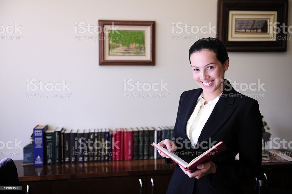 female lawyer at office reading a book royalty-free stock photo