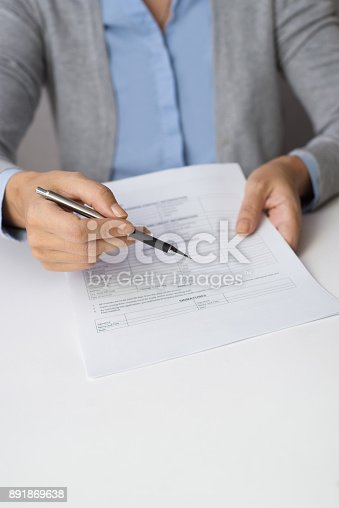 istock Female lawyer giving contract to client 891869638