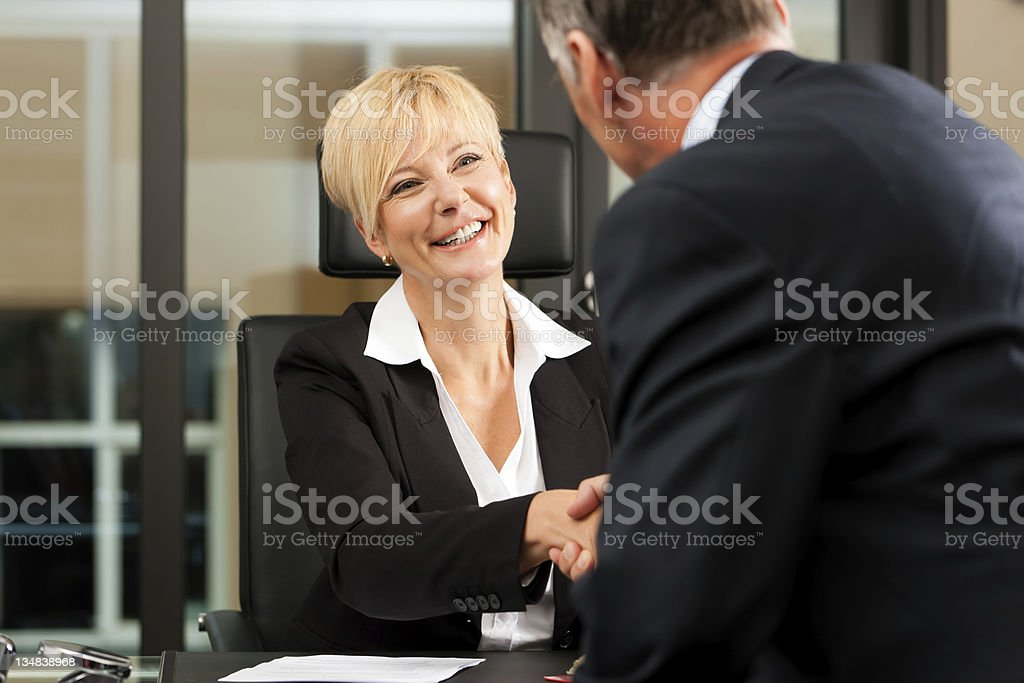 Female Lawyer or notary in her office stock photo