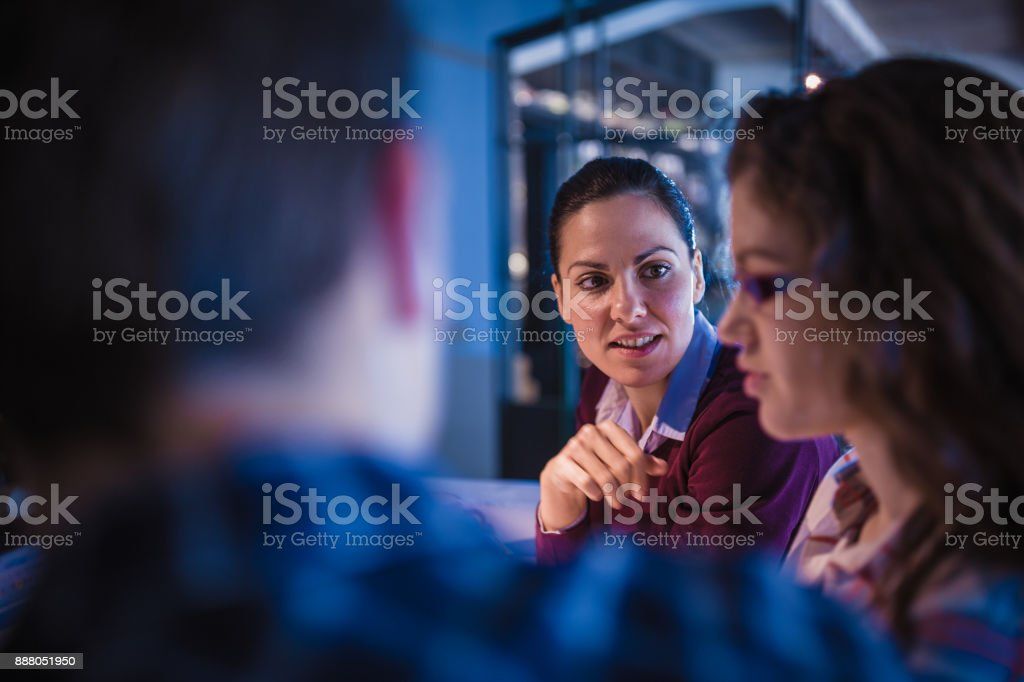 Creative, young, office coworkers talking during meeting together in...