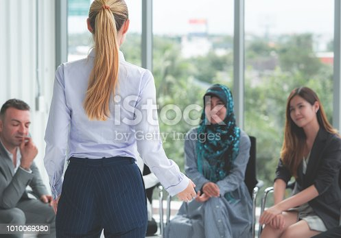 istock Female leading is speaking in a diverse meeting 1010069380
